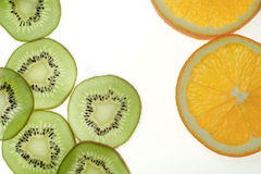 Sliced kiwi fruit and orange. On white background royalty free stock photos