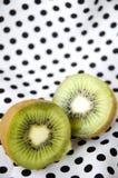 Sliced kiwi fruit on polka dots Royalty Free Stock Photo