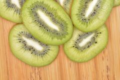Sliced kiwi fruit on wood table.  Stock Images
