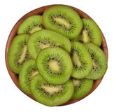 Sliced kiwi fruit in a wooden bowl on a white Stock Photography