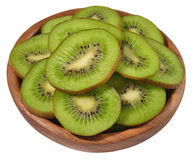 Sliced kiwi fruit in a wooden bowl on a white Royalty Free Stock Photos