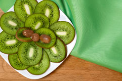 Sliced KIWI and grapes on a plate. Stock Photo