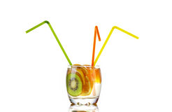 Sliced kiwi, lemon and orange in glass of water Stock Photos