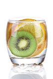 Sliced kiwi, lemon and orange in glass of water Royalty Free Stock Image