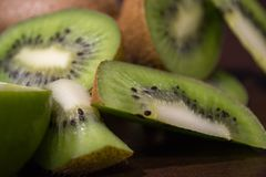 Sliced kiwi with lime on a dark brown wooden table. Sliced kiwi with lime on a dark brown wooden table stock photography