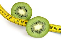 Sliced Kiwi and Measuring Tape Royalty Free Stock Photos