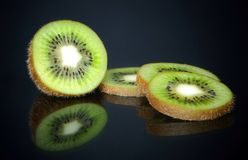 Sliced kiwi in reflection stock images