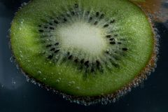 Sliced kiwi in water royalty free stock images