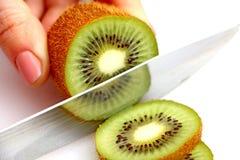 Sliced kiwi on wheels royalty free stock photos