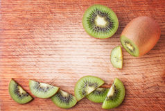 Sliced Kiwi on the Wooden Background Stock Images