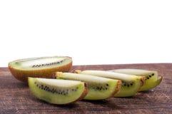 Sliced kiwi on wooden board isolated. Sliced Fresh kiwi on wooden board isolated stock photos