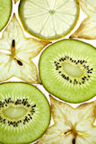 Sliced Kiwifruit, Lemon and Starfruit stock photography