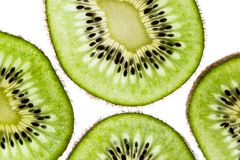 Sliced kiwifruit rings on white background top view macro stock image