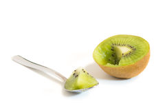 A sliced kiwifruit and spoon with a piece of kiwifruit Stock Photos