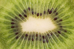 A sliced kiwifruit and spoon with a piece of kiwifruit Royalty Free Stock Image