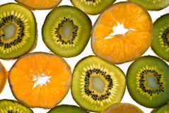 Sliced kiwis and mandarins. On a white background stock photography
