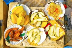 Sliced Konkani fruit like tamarind, amla or Indian gooseberry, raw mango and Star Fruit or Carambola for sale at Nagaon beach. Maharashtra, India Royalty Free Stock Images