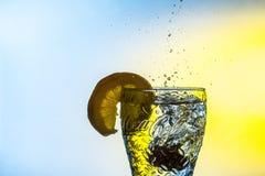 Sliced Lemon on Clear Glass royalty free stock photos