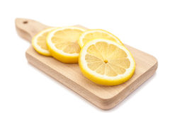 Sliced lemon on cutting board Royalty Free Stock Photo
