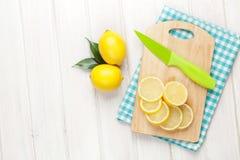Sliced lemon on cutting board Stock Photos