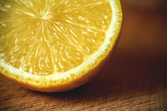Sliced lemon on a cutting board .wooden background Stock Image