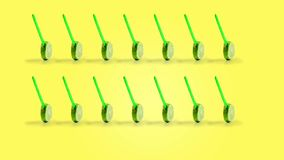 Sliced lemon fruit on a stick rotating, yellow background stock video
