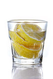 Sliced lemon in glass of mineral water Stock Photography