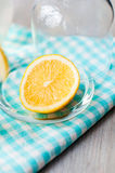 Sliced lemon with a glass of water. Sliced lemon with water in the glass Royalty Free Stock Photography