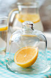 Sliced lemon with a glass of water. Sliced lemon with water in the glass Royalty Free Stock Photos