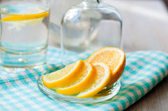 Sliced lemon with a glass of water. Sliced lemon with water in the glass Royalty Free Stock Image