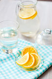 Sliced lemon with a glass of water Stock Photo