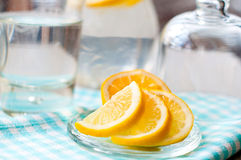 Sliced lemon with a glass of water Royalty Free Stock Images