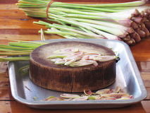 Sliced lemon grass on a wooden cutting board in the tray Royalty Free Stock Images