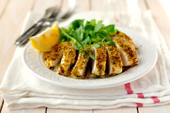 Sliced lemon herb crusted chicken breast royalty free stock image