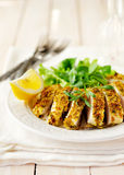 Sliced lemon herb crusted chicken breast, copy space for your text Royalty Free Stock Photography