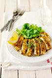 Sliced lemon herb crusted chicken breast, copy space for your text Royalty Free Stock Photos