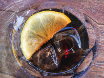 Sliced lemon ice cube with drink in the glass. Background, texture, cold, delicious, wooden, Sliced lemon ice cube with drink in the glass Stock Image