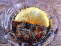 Sliced lemon ice cube with drink in the glass. Background, texture, cold, delicious, wooden, Frozen bubble Royalty Free Stock Photography