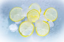 Sliced Lemon on Ice Water Stock Image