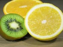 Sliced lemon, kiwi and orange close up. Sliced lemon, kiwi and an orange close up Stock Photo