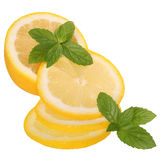Sliced lemon with mint leaves Royalty Free Stock Photos