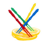 Sliced lemon and multicolored plastic skewers Stock Photography