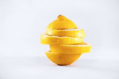 Sliced lemon. Picture before white background Royalty Free Stock Photos