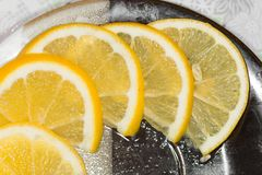 Sliced lemon on a plate. Photo in the studio Stock Image