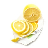 Sliced, lemon on a plate on a white background. (with sample text Royalty Free Stock Photos