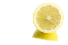 Sliced lemon on reflection background. Sliced lemon on white reflection background Royalty Free Stock Images