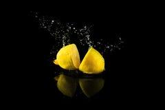 Sliced lemon splash Royalty Free Stock Photos