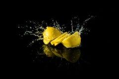 Sliced lemon splash Royalty Free Stock Images