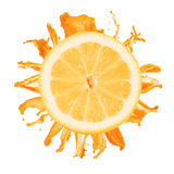 Sliced lemon splash with orange juice isolated Stock Photography