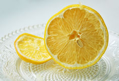 Sliced lemon on transparent saucer Royalty Free Stock Photo